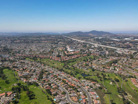 Aerial view of residential neighborhood surrounded by golf and valley during sunny day in Rancho Bernardo, San Diego County, California. USA.