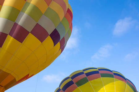 Colorful hot air balloons over blue sky in California