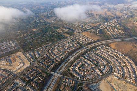 Aerial view pover the cloud of Carmel Valley with suburban neighborhood San Diego, California, USA.