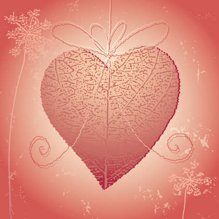 heart clipped on a leaf with a rope, a bow and some flowers on a rusty background