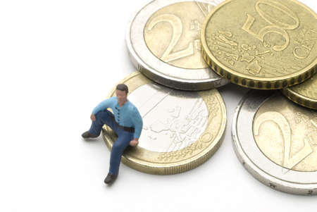 Man (puppet) sitting on Euro coins