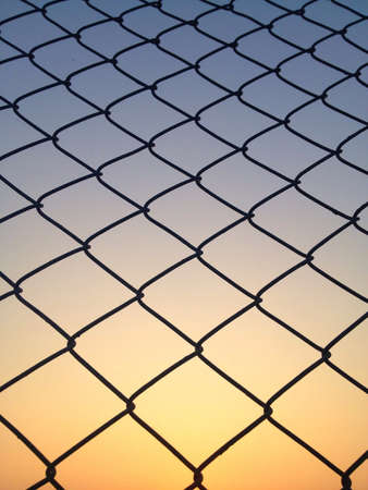 wire: Wire cage under sunset  Stock Photo