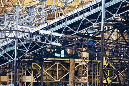 docker: The tangled structure of a crane at Savona port.