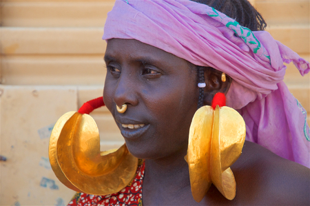 DJENNE, MALI, JAN 4: Portrait of a young African girl wearing two large earrings as ethnic ornament on January 4 2010 in Djenne, located in the Mopti region of Mali