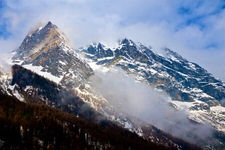 A view of the big mountains in Gran Paradiso National Park, located in Val dAosta, Italy. These are the typical Alps and not far there is the highest peak of Europe, the Monte Bianco.