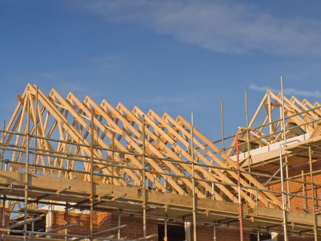 urban sprawl: Wooden roof trusses on a house in the process of being constructed