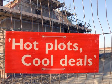 first time buyer: Sign on fence in front of new house construction