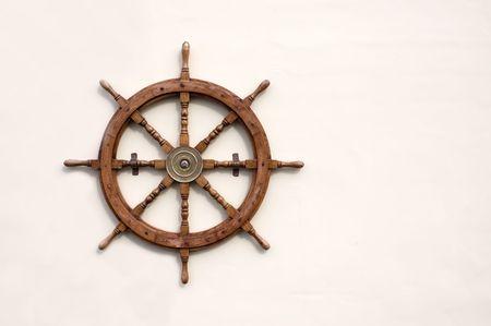 Ornamental ships wheel mounted on a wall
