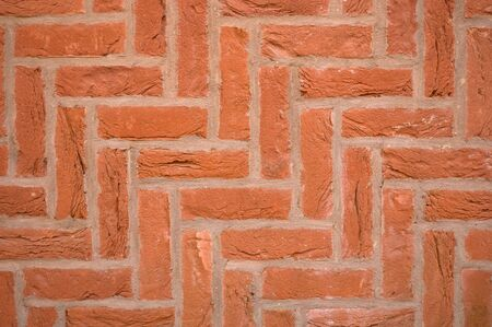 Brick wall using a diagonal herringbone pattern bond