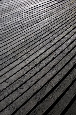 High-density polyethylene HDPE wood effect texture planks used for decking - a polyethylene thermoplastic made from petroleum.
