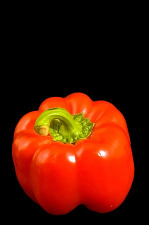 Single red Bell Pepper on a black background