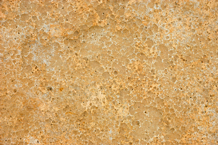 Weathered and pitted sandstone slab background texture Stock Photo