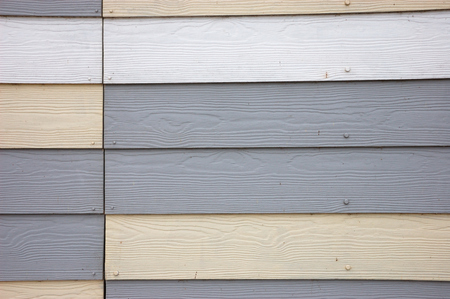 Grey and cream wood effect textured pvc cladding Stock Photo