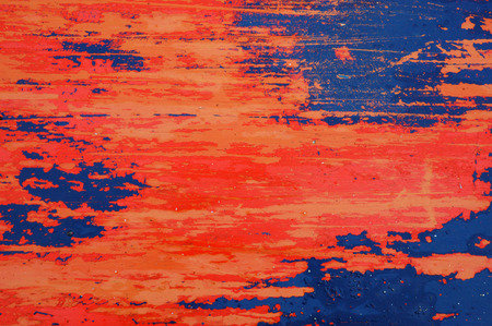Background texture of red and blue paint peeling off a metal plate Stock Photo