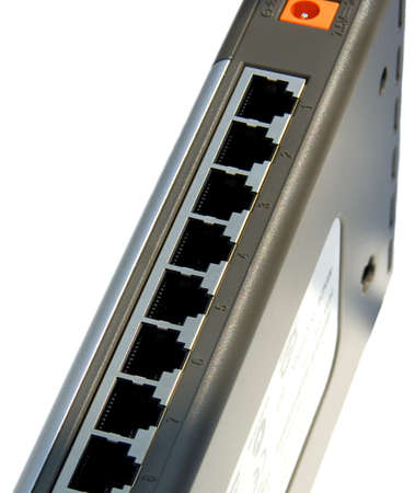 bps: 10100Mbps ethernet 8-ports switch isolated on the white background Stock Photo
