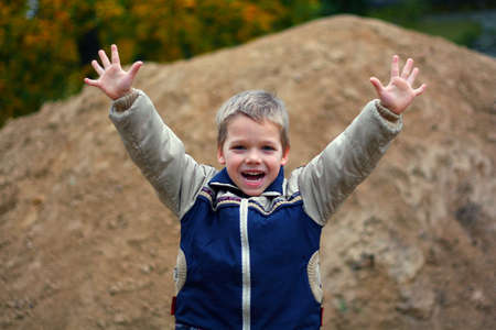 simply: Little boy screaming and wave with his arms Stock Photo