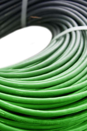 hank: Hank of a black-green network cable on a white background