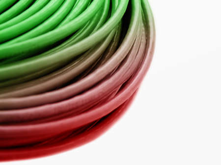 hank: Hank of a green-red network cable on a white background Stock Photo