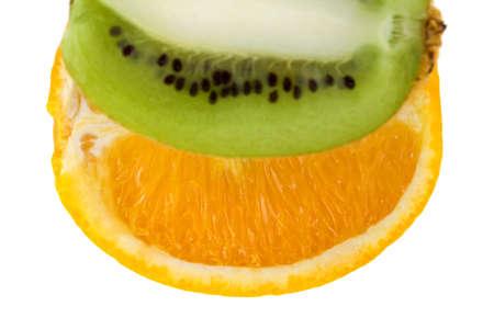 Fresh orange and kiwi isolated on white background. With focus on orange. photo