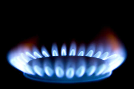 Close up of a gas burner isolated on black background