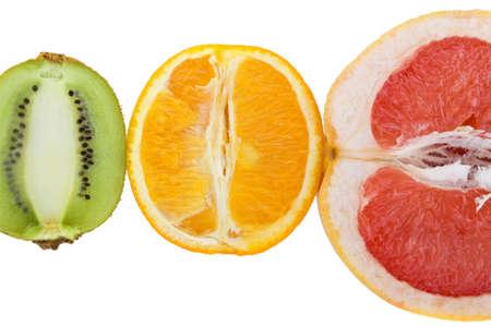 Fresh grapefruit, orange and kiwi isolated on white background photo