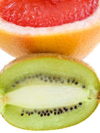 Fresh grapefruit and kiwi isolated on white background photo