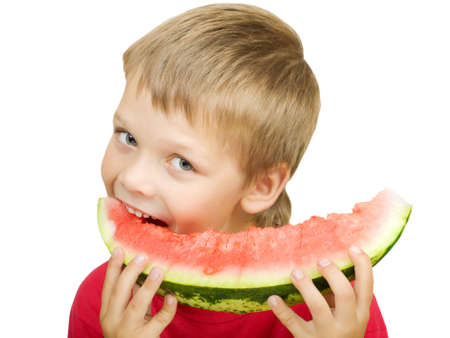 red tshirt: Boy in a red t-shirt taking a bite from a juicy watermelon