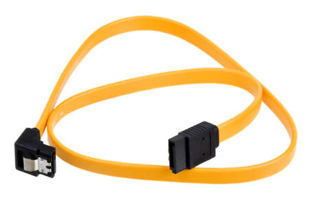 Yellow computer sata cable for connect drive isolated on white background photo