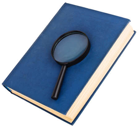 Blue book and magnifying glass isolated on the white photo