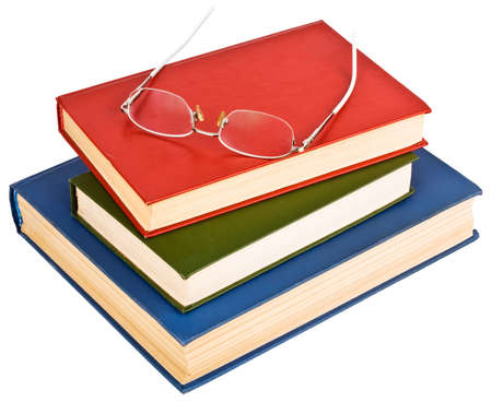 Glasses on a pile of books, isolated on white background photo