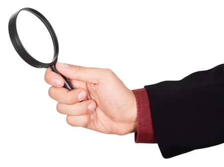 Hand holding magnifying glass, isolated on a white background Standard-Bild