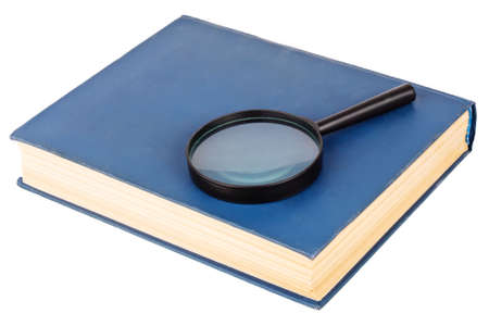 Magnifying glass on a blue book, isolated on white background photo