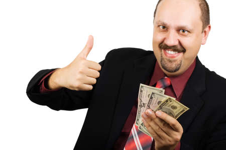 american banker: Happy businessman wearing red shirt and tie giving the thumbs up sign and holding US dollars in other hand
