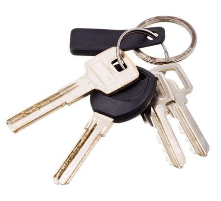 Klucze: PÄ™czek klucze z elektronicznego klucza odizolowane na biaÅ'ym tle  Zdjęcie Seryjne