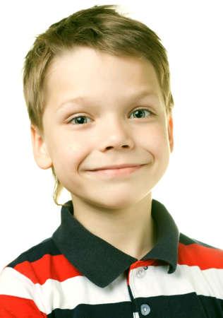 Adorable 7 year old European boy against white background photo