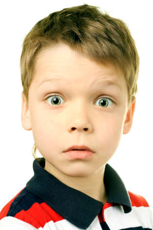 Surprise concept - boy with funny amazed expression on white background Stock Photo - 7116025