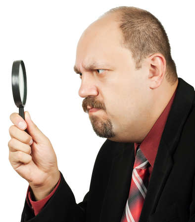 Man with magnifying glass over white background