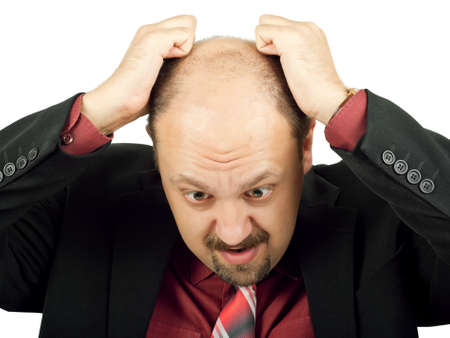 Businessman in depression with hands on head isolated over white photo