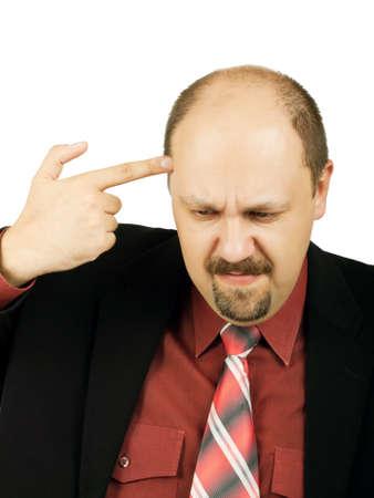 Economic depression. Businessman pointing his handgun to his head photo