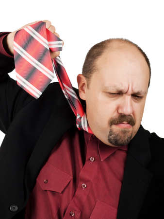 Businessman hung on the tie. Concept - Problems in the business. photo