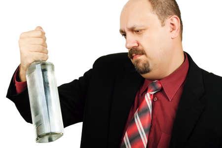 Depressed alcoholic man isolated on white background Stock Photo - 7217667