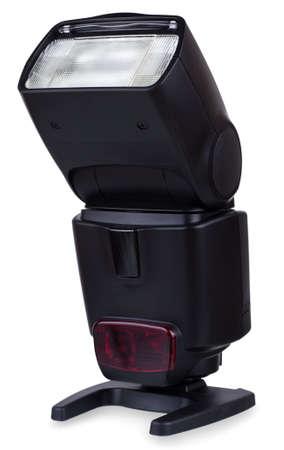 Photo of the camera flashgun isolated on the white background photo