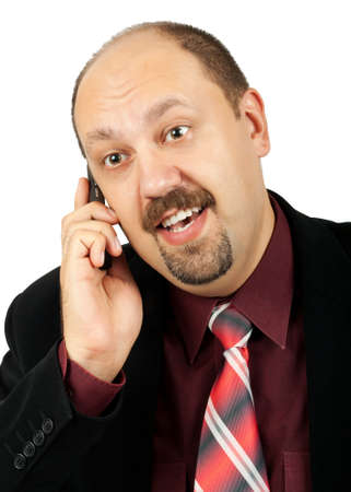 Serious businessman talking by mobile phone, and receiving good news, isolated on white background Stock Photo - 10049192