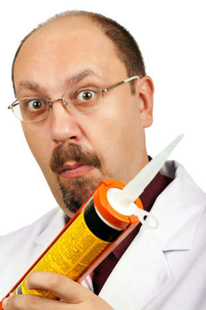 Crazy bald-headed Doctor with silicone gun isolated on white background. Grimacing funny face! photo