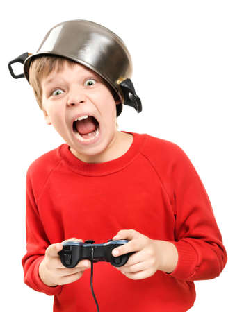Shouting boy with a pan on the head and the gamepad in hands is isolated on a white background  Very emotional
