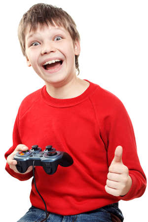Happy boy with gamepad in hands is isolated on a white background. Very emotional.