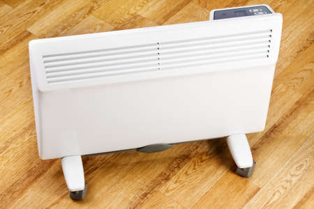 Heating convector in room on wooden floor Stok Fotoğraf