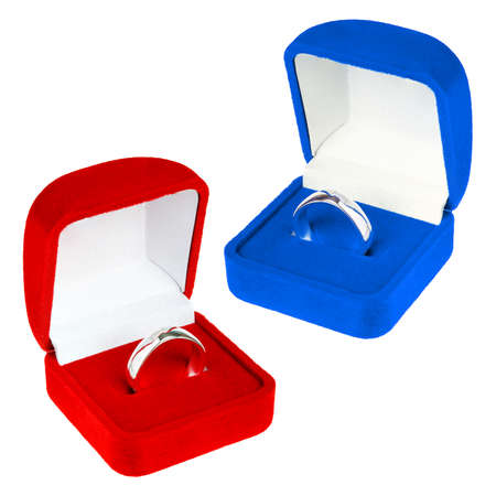 Red and blue velvet boxes with platinum ring photo
