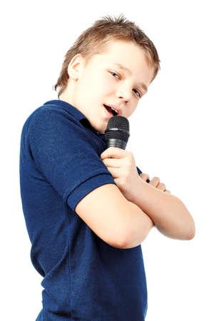 Boy singing into a microphone Standard-Bild