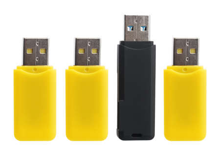 microdrive: Yellow and black USB flash drives isolated on white background